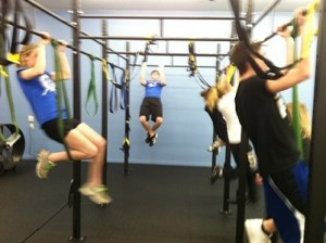 Image of strength training in a high school summer conditioning program.