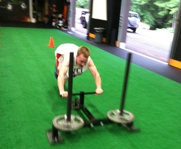training young athletes with prowler sprints